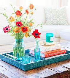 Decorate your coffee table with some of these fun ideas. These colorful ideas are perfect for summer. Give your coffee table a pop of color and added interest with these decorating ideas.