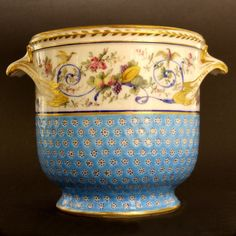 A Fine 18th Century Sevres Porcelain Seau a Bouteille (Bottle Cooler) from the First Republic Period July 1793 - 1804. The Upper Register Decorated with a Meandering Acanthus Scroll in Blue Enamel with Informal Garden Flowers, Fruit, Birds and a Classical Style Urn. The Base with a Large Mark in Blue Enamel : a Script `Sevres` Below an Intertwined Script `RF` for Republic Francaise, Below that the Painters Mark `F C` Who is an Unidentified Painter of Flowers who Worked at Sevres in c…