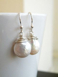Wedding Jewelry Bridal Pearl Earrings Coin Pearl Wire Wrapped Sterling Silver Dangle Earrings - GemE5. $30.00, via Etsy.