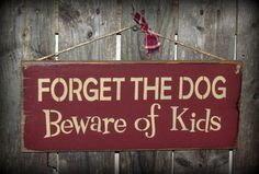 Wood Sign, Forget The Dog Beware of The Kids / Humorous Pet Sign. $14.95, via Etsy.