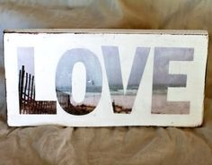 Letters cut out of single photograph and placed on painted wood