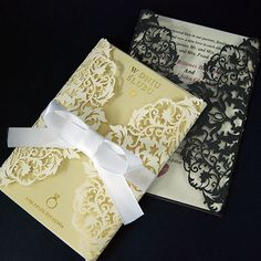 100pcs  lace invitations by WeddingFavorStore on Etsy; Comes in a couple of colors, but I would be limited to pearlescent ivory.