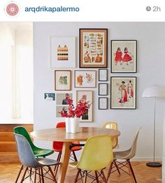 Midcentury style chairs and tables mixed with modern style art...nice combo .