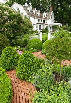 The Colonial Revival garden is not confined just to herbs. It also doubles as a potager and includes perennials