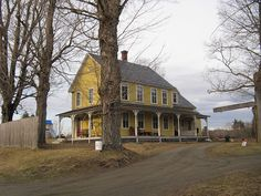 Yellow farm house with wraparound porch. has the makings of my dream house