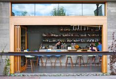 "Spoonbar opens right onto the street. Mixologist Scott Beattie sources local liquors and organic fruits and herbs for the cocktails. An extensive ""keg program"" with wines on tap reduces packaging and spoilage."