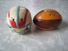 Mid Century Football salt and pepper shaker set. Helmet and ball. kitchen collectible chalkware shakers hand painted accents. by PickleladyVintage on Etsy