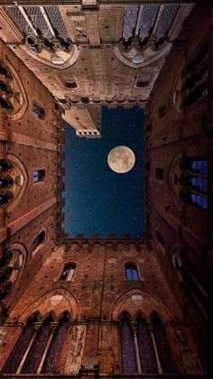 The Moon And The Castle - Photography by Mauro Maione Full moon viewed from the Town Hall building in Siena, Italy.