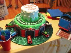 Cool Thomas the train cake idea....the bottom is the shed,you can put the die cast trains in front of their number...