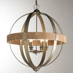 """Metal and Wood Globe 6-Light Chandelier Introduce a rustic element into your home with this 6-Light Metal and Wood Globe Chandelier. Works with a variety of trending design styles from urban farmhouse to industrial. 4.75"""" canopy and 29"""" chain and wire provided. (26.25""""H x 26.25""""D) 6 x 25W"""
