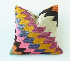 This handwoven kilim pillow is made from Anatolia and Middle-East Kilim fragments. Each of our pillow cover is cut from an old carpet/kilim and