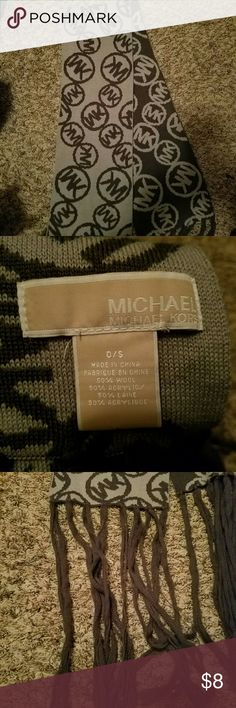MK scarf Michael Kors scarf. Light Grey on one side and dark grey on the other. The ends are pretty worn, but still keeps you warm! Michael Kors Accessories Scarves & Wraps