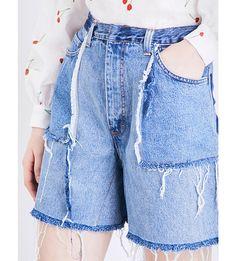 KSENIA SCHNAIDER Distressed high-rise denim shorts