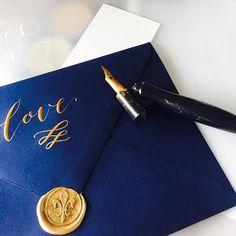 Fleur de lis wax seals in shimmery gold on dark navy envelopes. Check my Instagram stories to see today's studio scatter + one fine photographer x calligrapher collab.   #thatsdarling #waxseal #envelope #calligraphy #weddingstationery #sydneyfolk #bridebook #bridalmusings #thewildbride