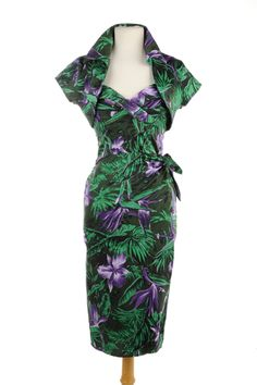 Much like the classic Hawaiian dresses from the 1950s, the Malibu Tiki Dress is made from a stretch cotton, has a fully built in bullet bust with padding, and a sweet little side tie, includes a matching bolero!