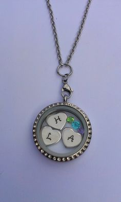 Hand Stamped personalised floating living locket with hearts and birthstones £21.00