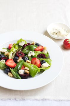 Triple Berry Salad with Walnuts - used strawberries, blueberries and raspberries. Goat cheese + avocado