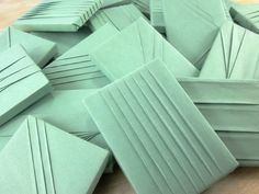 Colorful mint green origami packaging.