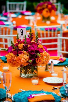 Wedding Flowers bright orange and pink centerpiece on orange and aqua table linens - 10 fabulous modern wedding centerpieces to inspire your own decor choices. Orange Centerpieces, Modern Wedding Centerpieces, Wedding Table, Wedding Decorations, Wedding Ideas, Centerpiece Ideas, Wedding Planning, Quince Decorations, Quinceanera Centerpieces