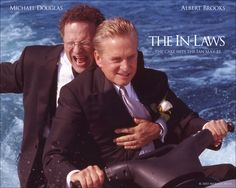 Watch Streaming HD The In-Laws, starring Albert Brooks, Michael Douglas, Ryan Reynolds, Lindsay Sloane. Right before his daughter's wedding, a mild-mannered foot doctor discovers that his new in-laws are international smugglers. #Action #Comedy #Thriller http://play.theatrr.com/play.php?movie=0314786