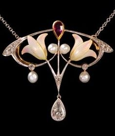 This lovely authentic Art Nouveau necklace consists of two subtly colored Bas Taille enameled flowers, four lustrous pearls and an inverted pear-shaped ruby on a fluid platinum and yellow gold frame. Tiny rose cut diamonds emphasize the refined lines of the pendant and a dangling pear-shaped 0.45ct diamond completes its graceful design. The pendant measures 1 ½ inches wide by 1 ¼ inches long.