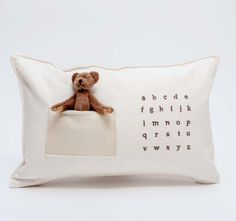 pilo.ca :  abc bear pillow. natural organic hemp fabric with embroidered alphabet in chocolate brown and felt pocket with removable teddy bear .