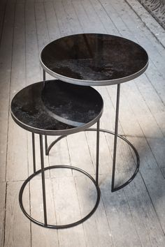 The Notre Monde Round Nesting side table set in Bronze.