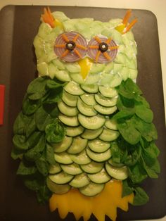 Owl  - Cool Veggie Pizza    Ingredients:  2 - 8 oz. packages of low fat cream cheese – softened  1 cup – low fat sour cream  2  - rolls reduced fat crescent rolls  1 bunch broccoli – chopped into small pieces  Dried dill – 1-2 TB to taste  Garlic powder – 1 tsp, to taste  Garlic Salt – 1/8 tsp or less – to taste  1 medium red onion  2 black olive halves  1 yellow pepper  4-5 baby carrots  1 bag of spinach