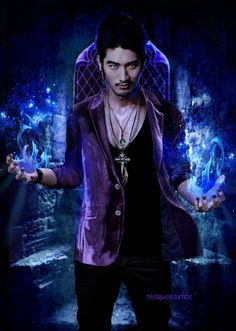 Magnus Bane played by Godfrey Gao ( I hope I have his name right.) So excited for the City of Bones movie.