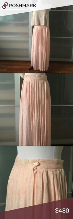 Vintage Pink maxi skirt Full length subtle printed maxi dress with button and zip closure // slimming pleats and soft print make this a perfect pick for summer // breathable lightweight fabric will keep you cool and pairs nicely with a flowy tank as seen in pic 1 // only the skirt is available for sale // one of a kind // marked as size 12, but fits a modern 4 // listing this as the size 4 that it fits // excellent condition // never worn by me // like new Vintage Skirts Maxi
