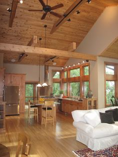 Rustic vaulted ceilings make for a spacious home designed by Udvari-Solner Design Company which specializes in residential design and is located in Madison, WI.