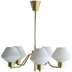 1950s Scandinavian Chandelier in Brass and Frosted Glass | See more antique and modern Chandeliers and Pendants  at http://www.1stdibs.com/furniture/lighting/chandeliers-pendant-lights