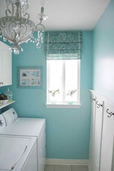 Who says laundry rooms should be the plainest rooms in the house when we spend so much time there? Love that chandelier.