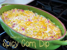 Hot-n-Spicy Corn Dip- Corn, tomatoes and cheese in a lightly spiced creamy blend of deliciousness, this Hot-n-Spicy Corn dip recipe is sure to be a party pleaser!
