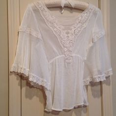 Free People Lace Top - Cream Free People cream flutter lace top. Will sell along with black version also listed $50 For both because you need to have both colors! Free People Tops Blouses