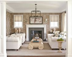 Neutral living room, quilted couch, quilted chair, RG Iconic Capital coffee table - At Home with Bill and Giuliana Rancic | Traditional Home