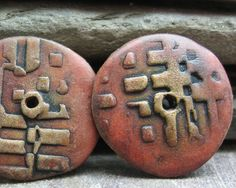 Polymer clay disc beads in shades of redorange by atLoganSquare, Love the color blending she used.