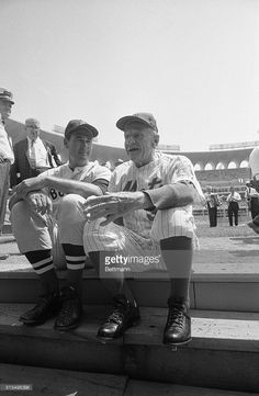 Baseball's two new Hall of Fame members Ted Williams, (L), and Casey Stengel, appear in uniform here, as honorary coaches for the annual All Star game. Williams wore his old Boston Red Sox uniform, while Stengel wore a New York Mets suit.