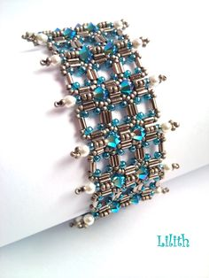 Lilith Pearl Jewelry: Verticals, pattern by Try to Bead, on Etsy.  This is a beautiful color story.