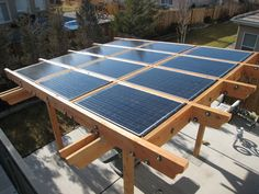 Pergola for solar panels...perfect way to conceal them if necessary in your neighborhood!