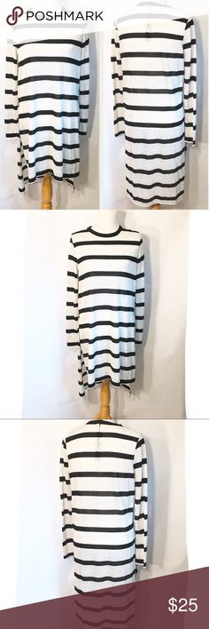 Zara striped AW Collection Long Sleeve hi lo tunic Good used condition  Crew neck Long sleeve  Hi-Lo Design with side slits Cream, black and silver striped (unfair silver doesn't show very well in pictures)  Very thin lightweight knit  Only flaw I see is the inside material & launder tag has been cut out Zara Tops Tunics