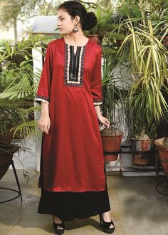 Look impressive in this readymade #maroon straight cut #kurti crafted with #stonework and #resham embroidery.