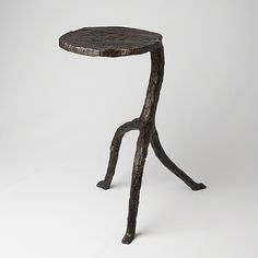 Inspired by the rugged look of hammered cast iron, the Studio A Walking Sticks Table gives off rustic charm. The eye-catching asymmetrical design gives it playful energy. The durable iron base is finished in an antique bronze tone to complete the effect.