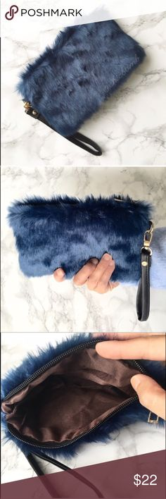 """Fur ball modern chic wristlet in dark blu teal Classy high fashion faux fur clutch wristlet in dark regal blue. Prettiest of shade for casual to formal look. 8x5"""" lining interior. ❤️❤️❤❤️️Follow me on  INSTAGRAM: @chic_bomb  and FACEBOOK: @thechicbomb❤️❤️❤️❤️ CHICBOMB Bags Clutches & Wristlets"""