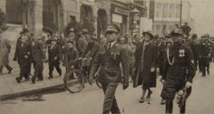 Betar march through Warsaw streets during Betar Third World Conference. Aharon Propes marches at front; Uri Zvi Greenberg behind him.