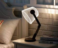 Add a touch of style to your nightstand or reading nook with this illusion LED night light. Although the lampshade is actually flat, it creates a neat optical illusion that makes it seem like it's three dimensional when you flick the light on. Roller Coaster Costume, Dorm Room Desk, Dorm Room Accessories, Desk Lamp, Table Lamp, Lego Hogwarts, Fireplace Logs, Gadget Gifts, Cozy Living Rooms