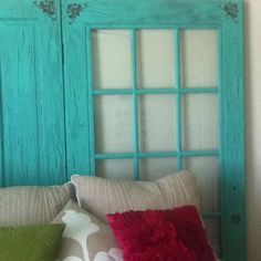 Reuse old doors as a headboard. I painted these in a crackle finish. Used brown base coat, let dry, painted Elmer's glue on, then painted the turquoise color before the glue completely dried. (way cheaper than crackle paint)
