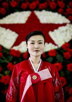 Pausing at the Kimjongilia North Korea: Kimjongilia is a flower named after the NK dictator.