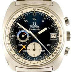 1972 Omega Seamaster Chrono Automatic ref. 176.0007 cal. 1040.  Plexiglass double domed crystal and barrel-shaped steel case. Cal. 1040 with large center chronograph seconds and minutes hands. 12 hour counter at 6 o'clock, continues small seconds hand, 24-hour indicator at 9 o'clock and date. Made in 5 dial/cases configuration:      blue dial + white tachymeter and white 12-hour sub-dial     blue dial + white tachymeter and gray 12-hour sub-dial     blue dial + white tachymeter and black…
