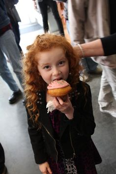 Actress Francesca Capaldi takes a big bite from a holiday muffin at   the Los Angeles Premiere of 3 Day Test.